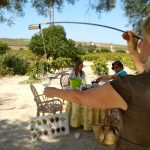 Venencia Workshop, pouring wine in the glass. Winery Spirit Sherry Visit special dinne in the vineyard